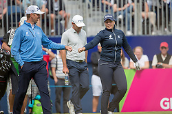 Iceland's Valdis Thora Jonsdottir and her playing partner Kristian Krogh Johannessenfist pump each other after her opening tee shot during day ten of the 2018 European Championships at Gleneagles PGA Centenary Course.