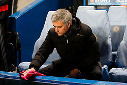 Chelsea Manager Jose Mourinho (POR) dries off his dugout pre match - Photo mandatory by-line: Rogan Thomson/JMP - 18/03/2014 - SPORT - FOOTBALL - Stamford Bridge, London - Chelsea v Galatasaray - UEFA Champions League Round of 16 Second leg.