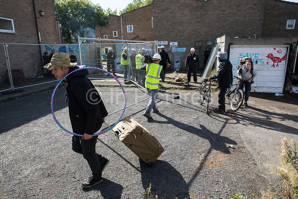 Housing activists remove their belongings after being evicted by bailiffs from properties on the Sweets Way housing estate on 23rd September 2015 in London, United Kingdom. A group of housing activists calling for better social housing provision in London had occupied some of the properties on the 142-home estate in Whetstone, in some cases refurbishing properties intentionally destroyed by the legal owners following eviction of the original residents, in order to try to prevent the eviction of the last resident on the estate and the planned demolition and redevelopment of the entire estate by Barnet Council and Annington Property Ltd.