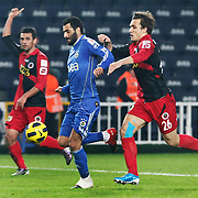 Fenerbahce's Daniel Gonzalez GUIZA (C) and Genclerbirligi's Mahmut BOZ (R) during their Turkey Cup group c matchday 5 soccer match Fenerbahce between Genclerbirligi at the Sukru Saracaoglu stadium in Istanbul Turkey on Thursday 27 January 2011. Photo by TURKPIX