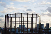 An Empty gas holder by a canal in East London 20th November 2015. Most of London's house holds are heated by gas and gasholders around the city used to be for storage. Most of the gasholders have now been decommissioned by National Grid including this one in Hackney.