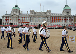 © licensed to London News Pictures. LONDON, UK.  06/06/11. The USA Army Band on Horse Guards Parade. The United States Army Band join with the Massed Bands and Corps of Drums of the Household Division to rehearse Beat Retreat at Horse Guards Parade. The event takes place on 8th and 9th June for featuring the US band the first time. The US visit comes two weeks after the State visit to London of the US President..  Photo credit should read Stephen Simpson/LNP