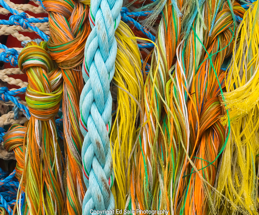 Brightly colored ropes, lines, and nets intermingle with unique lines and patterns