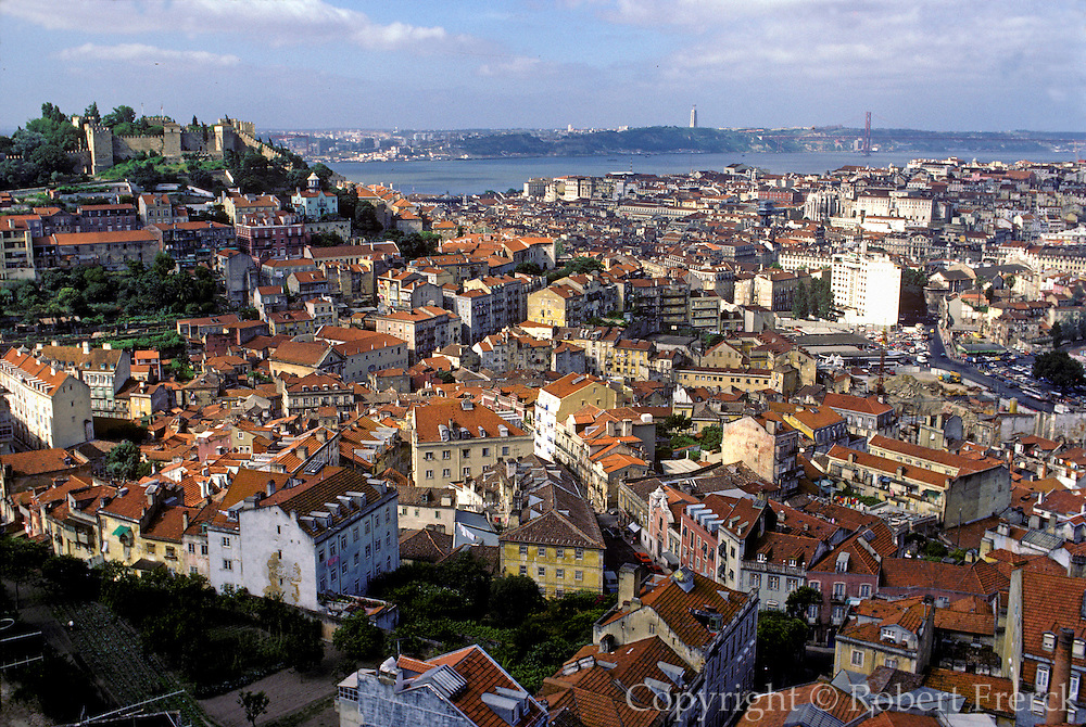 PORTUGAL LISBON, Castelo de Sao Jorge, left and the Baixa area (the old city) center, with the Tagus Riverfront beyond
