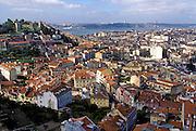 PORTUGAL LISBON, Castelo de Sao Jorge, left and the Baixa area (the old city) center, with the Tagus Riverfront beyond