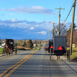 Ronks, PA / USA - January 10, 2016:  Amish Buggies on Lancaster County road.