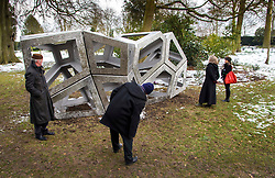 © Licensed to London News Pictures. 27/03/2013 Hatfield UK. Visitors to Hatfield House, Herts admire Richard Deacon's 'Congregate'. The sculpture is part of a Royal Academy exhibition that showcases six of their sculptors.This is the first time that the Royal Academy of Arts has collaborated with another organisation to curate an exhibition of Royal Academicians' sculpture outside the Royal Academy..Photo credit : Simon Jacobs/LNP