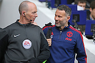 Ryan Giggs, the Manchester United Coach talks to Referee Mike Dean as both player and Referee walk out from the tunnel before k/o. Barclays Premier league match, Tottenham Hotspur v Manchester Utd at White Hart Lane in London on Sunday 10th April 2016.<br /> pic by John Patrick Fletcher, Andrew Orchard sports photography.