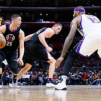 16 January 2016: Los Angeles Clippers guard Austin Rivers (25) drives past Sacramento Kings guard Rajon Rondo (9) on a screen set by Los Angeles Clippers center Cole Aldrich (45) and faces Sacramento Kings center DeMarcus Cousins (15) during the Sacramento Kings 110-103 victory over the Los Angeles Clippers, at the Staples Center, Los Angeles, California, USA.