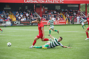 Ugur Naci Gök for Northern Cyprus with a tackle by Riccardo Ravasi. Northern Cyprus 3 v Padania 2 during the Conifa Paddy Power World Football Cup semi finals on the 7th June 2018 at Carshalton Athletic Football Club in the United Kingdom. The CONIFA World Football Cup is an international football tournament organised by CONIFA, an umbrella association for states, minorities, stateless peoples and regions unaffiliated with FIFA.