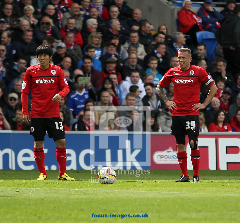 Picture by Mike  Griffiths/Focus Images Ltd +44 7766 223933.27/04/2013.Kim Bo-Kyung (L) and Craig Bellamy (R) of Cardiff City against Bolton Wanderers during the npower Championship match at the Cardiff City Stadium, Cardiff.