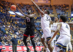Dec 14, 2019; Morgantown, WV, USA; Nicholls State Colonels forward Elvis Harvey Jr. (23) shoots in the lane while defended by West Virginia Mountaineers forward Oscar Tshiebwe (34) during the first half at WVU Coliseum. Mandatory Credit: Ben Queen-USA TODAY Sports