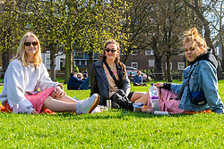 Friends Izzy Newton, 22, left, from Eastbourne, Sydney Turner, 22, from Hertfordshire and Hannah Pratt, 21, right, give their views on Brexit on Clapham Common in South London. London, March 24 2019.