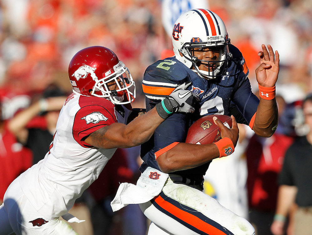 AUBURN - OCTOBER 16:  Quarterback Cam Newton #2 of the Auburn Tigers (right) is tackled by safety Tramain Thomas #5 of the Arkansas Razorbacks during the game at Jordan-Hare Stadium on October 16, 2010 in Auburn, Alabama.  (Photo by Mike Zarrilli/Getty Images)