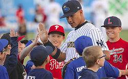 May 2, 2017 - Trenton, New Jersey, U.S - During the singing of the national anthem before the game vs. the Harrisburg Senators tonight at ARM & HAMMER Park, a few lucky kids get to stand on the baseball field with the players, and this one, who greets them at third base, is GLEYBER TORRES, the New York Yankees' famous top prospect who currently plays here for the Trenton Thunder. (Credit Image: © Staton Rabin via ZUMA Wire)