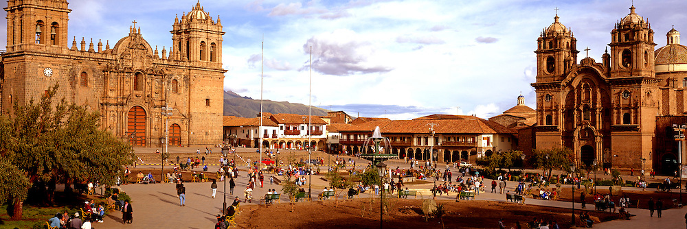 PERU, HIGHLANDS, CUZCO The Plaza de Armas, the heart of the old colonial city with the Cathedral, left and La Compania Church to the right