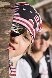 Boy dressed up as pirate playing in a playground, Bavaria, Germany