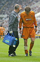 Photo. Andrew Unwin.<br /> Newcastle United v Wolverhampton Wanderers, FA Barclaycard Premier League, St James Park, Newcastle upon Tyne 09/05/2004.<br /> Wolves' Lee Naylor (r) walks off the field after receiving an injury.