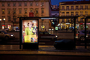"""In a bus stop where a beggar is sleeping, a Portuguese company advertises its liquor brand using digital composed images of German Chancellor Angela Merkel and French President Nicolas Sarcozy holding a Licor Beirão bottle, it can be read in the muppie among other things, """"Dear Angela. Portugal is giving its best. Happy Holidays."""" , in Lisbon, Portugal. 27/12/2011 IN SALES IN PORTUGAL"""