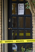 A no trespassing note posted outside the apartment where a second Ebola patient has been reported in Dallas, Texas on October 13, 2014. (Cooper Neill for The New York Times)