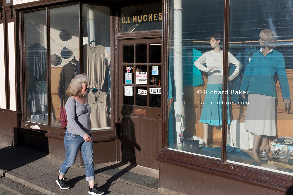 Faded fashions in the window of D.E. Hughes, on 12th September 2018, in Dolgellau, Gwynedd, Wales.