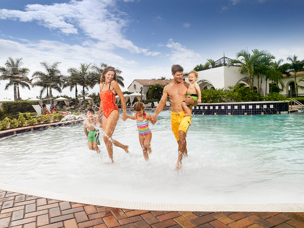Lifestyle family running in a pool