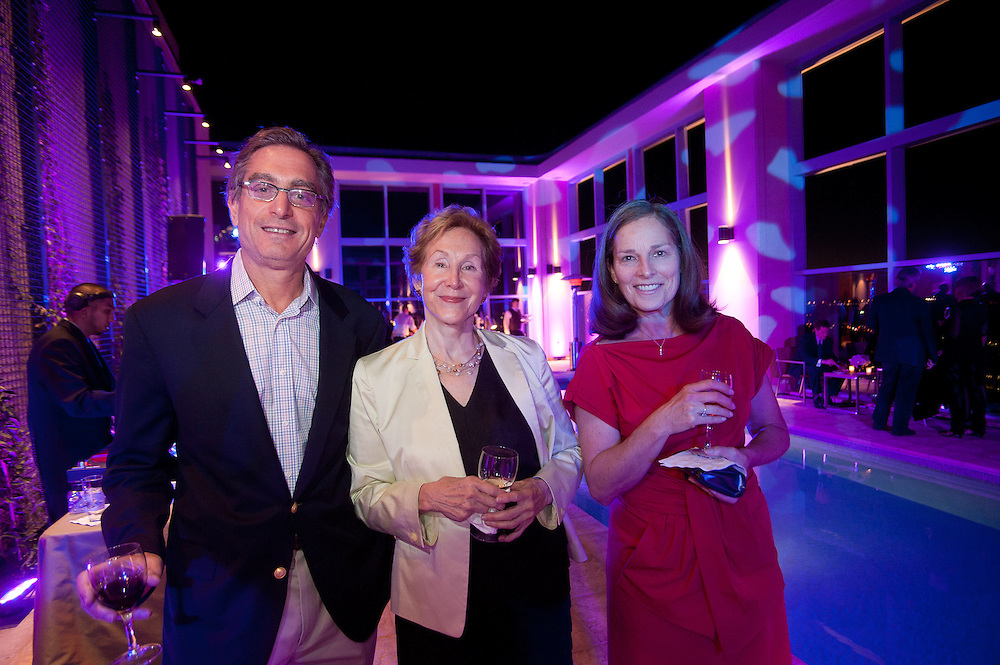 The Four Seasons Residences Austin hosted a party Friday night for current, future and prospective residents. David Rabban (L) Mary Willis and Lynn Stahl, join others  guest neat the pool.