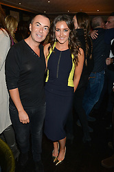 JULIEN MACDONALD and NATASHA CORRETT at a party to celebrate the publication of Honestly Healthy Cleanse by Natasha Corrett held at Tredwell's Restaurant, 4a Upper St.Martin's Lane, London on 14th January 2015.