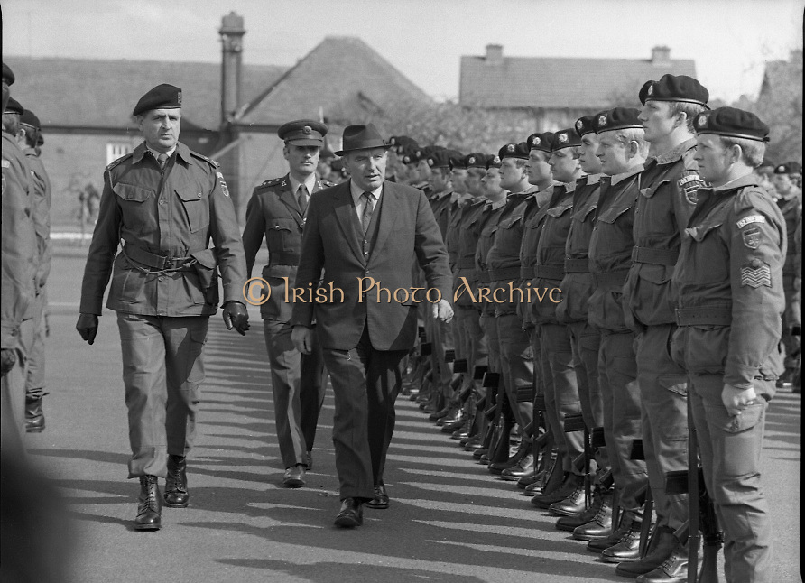 1983-04-12.12th April 1983.12-04-1983.04-12-83...Photographed at McKee Barracks, Cork..Reviewing the toops..From left to right:..Lieut Col. Thomas McGrath.Capt Walter Young.Defence Minister Patrick Cooney TD.