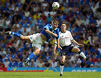 Photograph: Scott Heavey.<br />Birmingham City v Tottenham Hotspur. 16/08/2003.<br />Kenny Cunningham beats Robbie Keane to the ball.