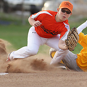 A runner slides into third base during the Norwalk Little League baseball competition at Broad River Fields,  Norwalk, Connecticut. USA. Photo Tim Clayton