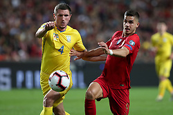 March 22, 2019 - Lisbon, Portugal - Portugal's forward Andre Silva vies with Ukraine's defender Sergii Kryvtsov during the UEFA EURO 2020 group B qualifying football match Portugal vs Ukraine, at the Luz Stadium in Lisbon, Portugal, on March 22, 2019. (Credit Image: © Pedro Fiuza/ZUMA Wire)