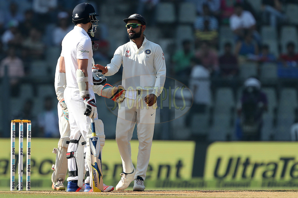 Virat Kohli Captain of India  and James Anderson of England  have words during day 5 of the fourth test match between India and England held at the Wankhede Stadium, Mumbai on the 12th December 2016.<br /> <br /> Photo by: Ron Gaunt/ BCCI/ SPORTZPICS