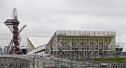 © Licensed to London News Pictures. 27/11/2012.. With the exterior wrap removed, the temporary skeletal structure of the Aquatic Centre is revealedToday the  Olympic Park was handed over from LOCOG to the London Legacy Development Company.Photo credit : Andrew Baker/LNP