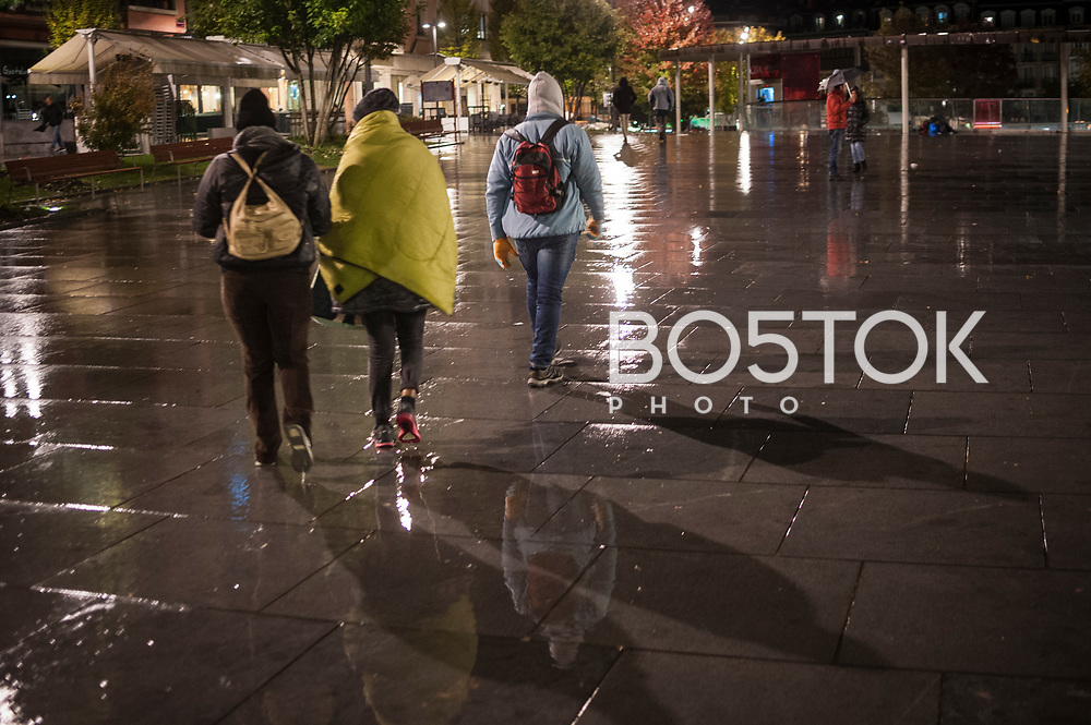Some African migrants under the rain and cold. Irun (Basque Country). October 29, 2018. A group of volunteers has created a host network to serve migrants and inform about the public services they are entitled to and the ways to cross the border. This group of volunteers is avoiding a serious humanitarian problem Irun, the Basque municipality on the border with Hendaye. As the number of migrants arriving on the coasts of southern Spain incresead, more and more migrants are heading north to the border city of Irun. French authorities have reacted by conducting random checks as far as the city of Bordeaux, more than 200 kilometers north of the border. Migrants who are caught are then deported back to Irun. (Gari Garaialde / Bostok Photo).