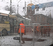 The Russian city being 'eaten alive': Cars, buses, and trucks disappear beneath the earth as they are swallowed by giant sinkholes<br /> <br /> They may look like stills from an apocalyptic horror film, but these images have become a daily reality for residents in a Russian city. <br /> Citizens of Samara, in south east Russia, live in fear of the ground literally disappearing beneath them after huge sinkholes have started to appear all over their city, leaving devastation in their wake. <br /> The yawning underground caverns are all believed to have sprung up in recent weeks swallowing cars, buses and claiming at least one life.<br /> The sinkholes, some large enough to swallow an entire truck, are believed to have been caused by ground subsidence. <br /> It is thought the holes have been caused as ice thaws and melts into the ground, with the excess water causing soil decay underneath Samara's roads. <br /> The massive craters have appeared in car parks, busy intersections, by the sides of roads, and on major and minor thoroughfares.<br /> <br /> It is believed at least one person has lost their life as a result of one of the crashes caused by the sinkholes. <br /> The citizens of the city have now signed a petition urging authorities to find a solution. <br /> Sinkholes are common hazards in mining regions, plaguing areas where miners have burrowed into layers of soluble minerals and accidental floods have followed.<br /> But natural sinkholes can take thousands of years to form and vary in size.<br /> They are usually the result of what are known as Karst processes, which occur when a layer of rock such as limestone underneath the ground is dissolved by acidic water.<br /> Typically rainfall seeps through the soil, absorbing carbon dioxide and reacting with decaying vegetation. As a result, the water that reaches the soluble rock is acidic.<br /> <br /> <br /> The acidic water then erodes the soluble rock layers beneath the surface creating cavernous spaces.<br /> Then, when it is no longer supported because of the cavity below, the soil or sand over the limestone co