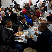 """The homeless and others down on their luck wait to be served a free meal prepared by Jean Webster -- known  as 'thee Mother Teresa of Jersey'. Jean and her staff prefer to call this gathering time """"The House of happiness,"""" which feeds 300-400 hungry, homeless people daily in the dining room of the First Presbyterian Church of Atlantic City. Feeding hours vary according to Winter & Summer. No one is turned away."""