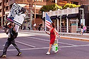 14 OCTOBER 2011 - PHOENIX, AZ:   People cross a city street to catch up to the Occupy Phoenix March. About 300 people participated in the Occupy Phoenix march through downtown Phoenix Friday evening, Oct. 14. The march was the first event in the Occupy Phoenix protests which start with the occupation of Cesar Chavez Plaza, a large square in downtown Phoenix.  PHOTO BY JACK KURTZ