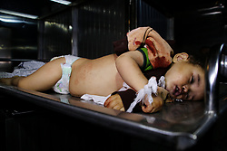May 4, 2019 - Gaza City, Gaza Strip, 04 May 2019. 14-months-old Saba Mahmoud Abu Arar lies at the Al-Shifa hospital in Gaza City after losing her life in an Israeli airstrike that hit her home in the al-Zaytoun neighbourhood, on the east of Gaza City, on Saturday.  Seba died immediately, while her pregnant mother was seriously wounded in an Israeli bombing on the east of Gaza City. The airstrike took place as Israel continued its aerial offensive on the Gaza strip (Credit Image: © Ahmad Hasaballah/IMAGESLIVE via ZUMA Wire)