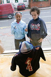 Two young friends out window shopping together,