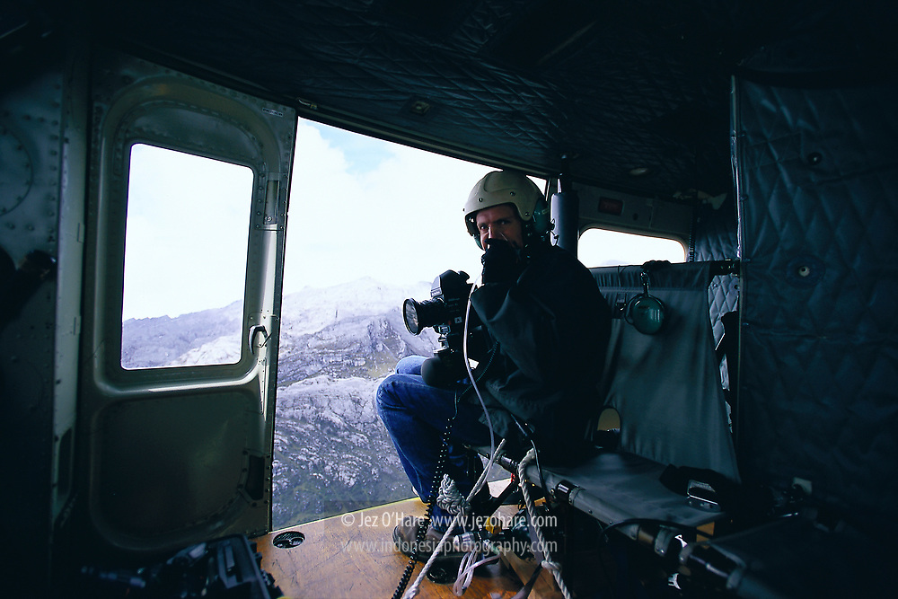 Jez O'Hare getting some oxygen whilst photographing for Freeport near Puncak Jaya, Papua, Indonesia.