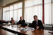 Arcelor Mittal. Omarska Mine near Prijedor.<br /> <br /> Nenad Marijanovic, center, and CEO Mladen Jelaca, right<br /> <br /> Matt Lutton / Boreal Collective for the Financial Times.