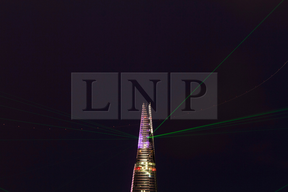 © Licensed to London News Pictures. 05/07/2012. London, UK.  A laser and light show can be seen from the bank of the River Thames projected from the Shard tonight (05/07) in honour of the 1,016ft skyscraper's inauguration.  Photo credit :James Gourley/LNP