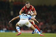 Scott Williams of Wales runs at Matias Orlando of Argentina. Under Armour 2016 series international rugby, Wales v Argentina at the Principality Stadium in Cardiff , South Wales on Saturday 12th November 2016. pic by Andrew Orchard, Andrew Orchard sports photography