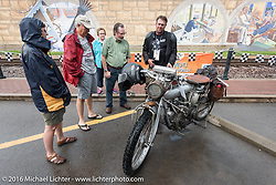 Spectators check out the rolling motorcycle museum that is the Cannonball in Cape Girardeau during the Motorcycle Cannonball Race of the Century. Stage-5 from Bloomington, IN to Cape Girardeau, MO. USA. Wednesday September 14, 2016. Photography ©2016 Michael Lichter.