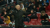 Football - 2018 / 2019 Premier League - Tottenham Hotspur vs. Burnley<br /> <br /> Sean Dyche, Manager of Burnley FC, with arms spreads questions the decision at Wembley Stadium.<br /> <br /> COLORSPORT/DANIEL BEARHAM