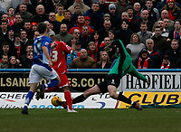 Chesterfield keeper Barry Roche brings down Junior Agogo for a penalty to Forest