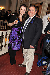 Left to right, actress EMMA SAMMS and NEIL SWAN Chief Executive Officer at Starlight at an after show party following the 1st preview show of the new show Top Hat in aid of the charity Starlight held at the Aldwych Theatre, London on 19th April 2012.