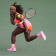 Serena Williams, of the United States, returns the ball to Monica Niculescu, of Romania, during their match at the Miami Open tennis tournament on Saturday, March 28, 2015 in Key Biscayne, Florida. (AP Photo/Alex Menendez)