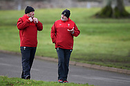 Warren Gatland, the Wales rugby team head coach ® chats to Robin McBryde , the assistant coach as they arrive for the Wales Rugby team training at the Vale Resort, Hensol near Cardiff, South Wales on Tuesday 30th January 2018.  The team are preparing for the the opening Natwest 6 nations match against Scotland this weekend.  pic by Andrew Orchard, Andrew Orchard sports photography.